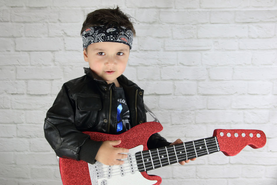 Little Boy Wearing a Bandana Playing Electric Guitar